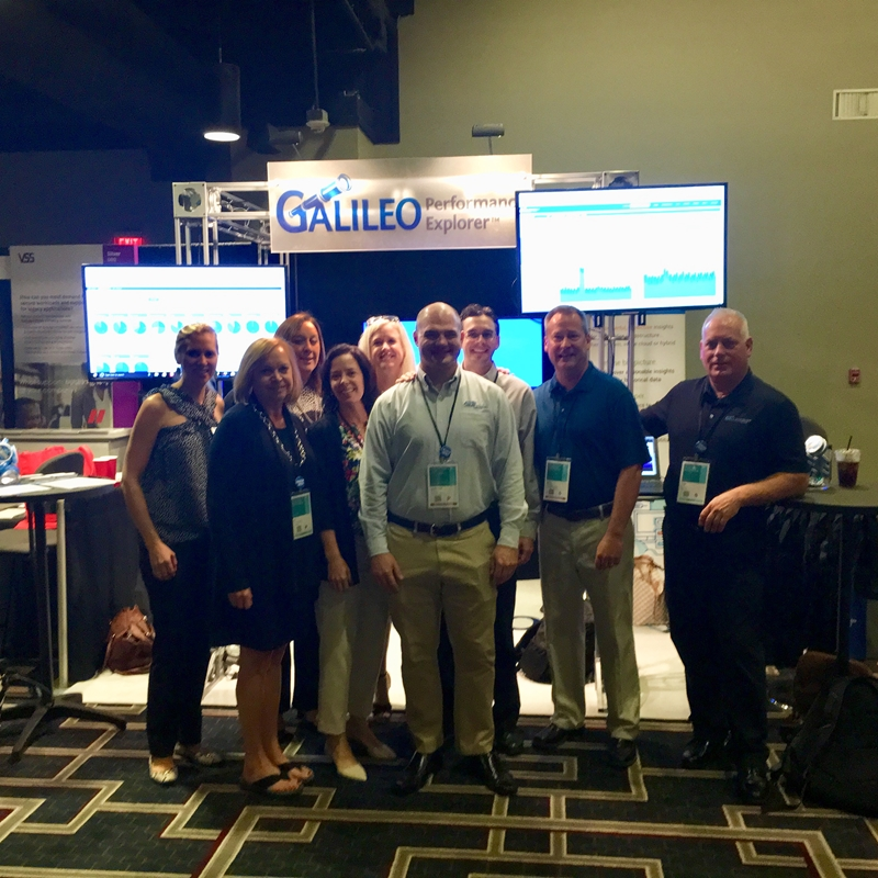 Galileo team standing in front of conference booth.